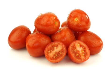 bunch of fresh and colorful italian plum tomatoes and two halves on a white background  Stock Photo - 15487537