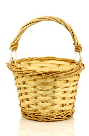 interleaved: empty wicker basket with handle on a white background