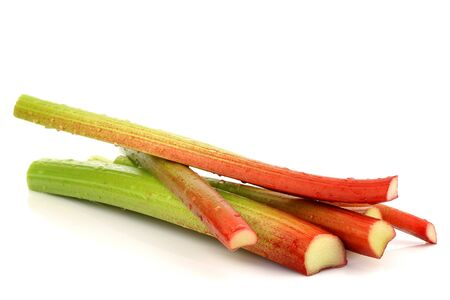 rhubarb: freshly cut stems of rhubarb on a white background