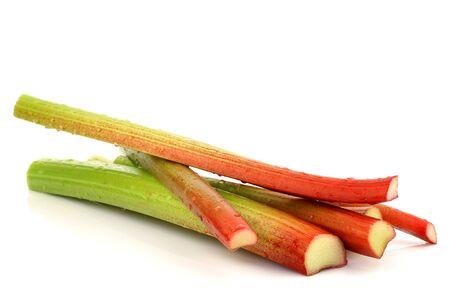 freshly cut stems of rhubarb on a white background 版權商用圖片 - 15050274