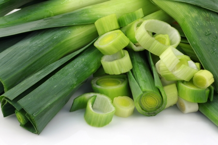 leeks: freshly cut leek on a white background