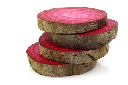 stacked fresh slices of cut beetroot on a white background  Stock Photo