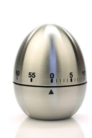 timescale: modern metal kitchen timer on a white background  Stock Photo