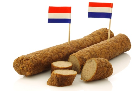Two Dutch snacks called  fricandel  with Dutch flag toothpicks and some cut pieces on a white background  版權商用圖片