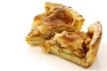 golden apple: two pieces of fresh apple pie on a white background