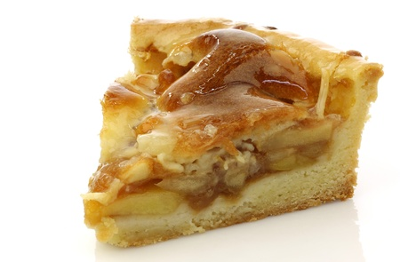 golden apple: fresh piece of fresh apple pie on a white background