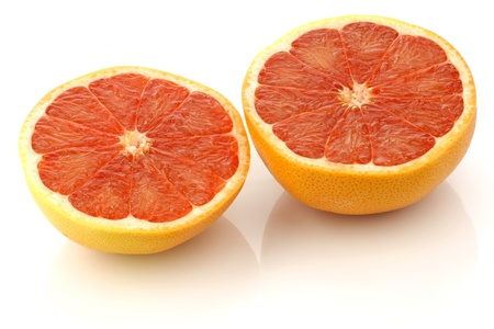 two fresh red grapefruit halves on a white background  photo