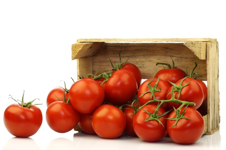 fresh tomatoes in a wooden crate on a white background  Stock Photo - 15085853