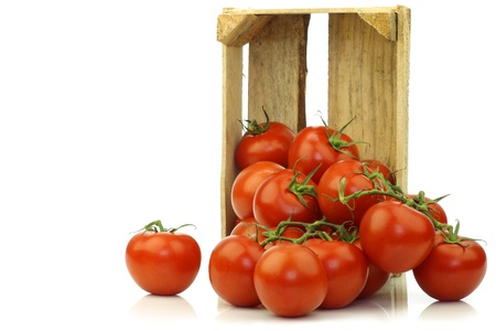 fresh tomatoes in a wooden crate on a white background Stock Photo - 15085846