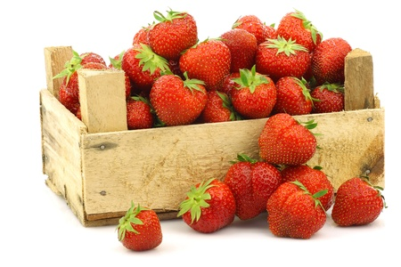 fresh strawberries in a wooden box on a white background  photo
