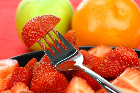 fresh strawberry piece on a fork background  photo