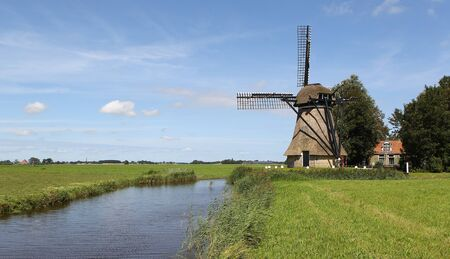 friesland: windmill in the rural part of Friesland Holland   Stock Photo