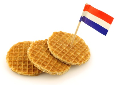 toothpick: traditional Dutch mini waffles called  stroopwafels  with a Dutch flag toothpick on a white background  Stock Photo