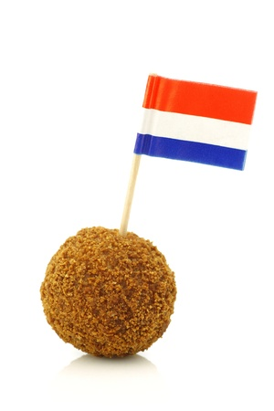 A real traditional Dutch snack called  bitterbal  with a Dutch flag toothpick on a white background