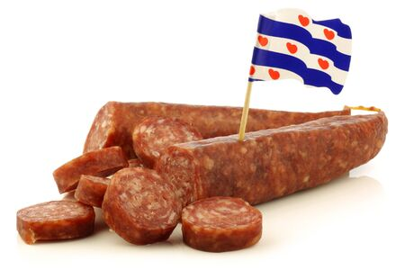 traditional frisian dried sausage pieces with a dutch flag toothpick on a white background  photo