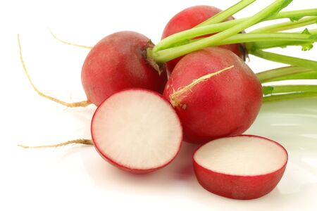 fresh radishes and a cut one on a white background  Stock Photo - 15487883