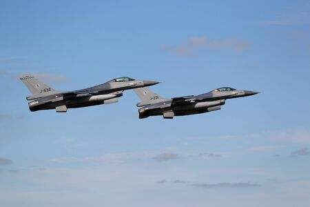 leeuwarden: LEEUWARDEN,FRIESLAN D,HOLLAND-SEPTEMBER 17: Two f-16 Fighter Jets in formation at the Airshow on september 17, 2011 at Leeuwarden Airfield