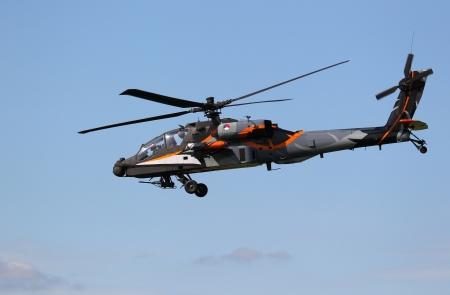 leeuwarden: LEEUWARDEN,FRIESLAN D,HOLLAND-SEPTEMBER 17:Apache AH-64D Solo Display Team performs at the Airshow on September 17, 2011 at Leeuwarden Airfield, Friesland, Holland.  Editorial