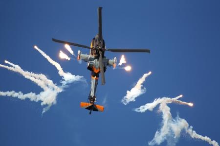 leeuwarden: LEEUWARDEN,FRIESLAN D,HOLLAND-SEPTEMBER 17:: Apache AH-64D Solo Display Team shoots flares at the Airshow on September 17, 2011 at Leeuwarden Airfield, Friesland, Holland.