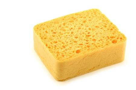 yellow household sponge on a white background  Stock Photo