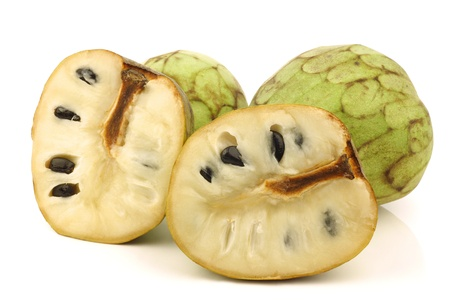 fresh cherimoya fruit  Annona cherimola  and a cut one on a white background  photo