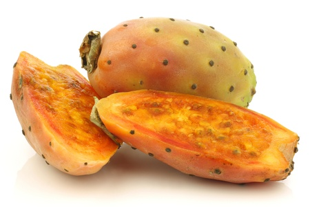 fresh colorful cactus fruit and a cut one on a white background  photo