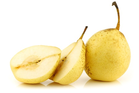 fresh nashi pear and a cut one on a white background  photo