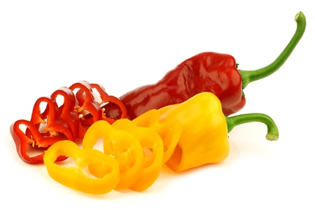 sweet peppers: cut red and yellow sweet pepper capsicum  on a white background  Stock Photo