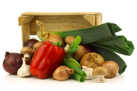 fresh assorted vegetables in a wooden crate on a white background  photo