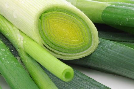 fresh cut leek and spring onions on a white background Stock Photo - 15106769