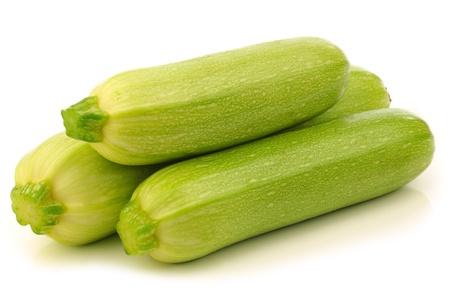 cucurbita: light green zucchini  Cucurbita pepo  on a white background