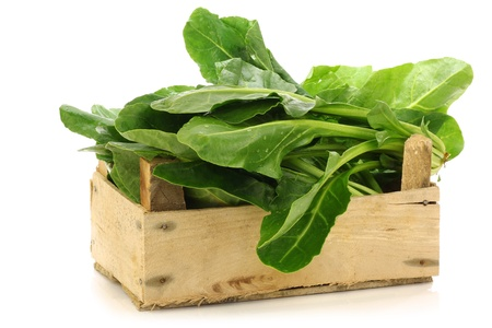 chinese spinach: chinese spinach  Ipomoea aquatica  in a wooden crate on a white background