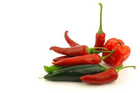 hot peppers: bunch of assorted red and green peppers  capsicum  on a white background