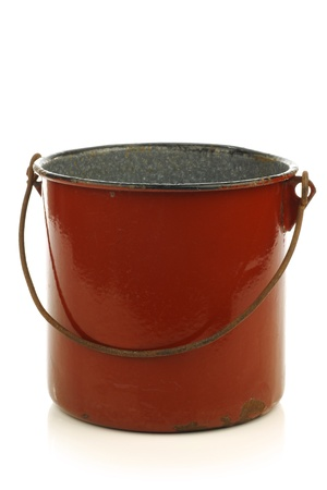 soup kettle: vintage brown enamel cooking pot with a handle on a white background