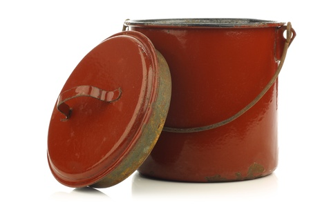 vintage brown enamel cooking pot with a handle on a white background