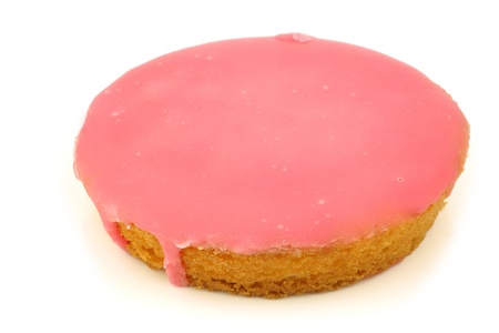 fattening: Traditional Dutch pink glazed cake on a white background