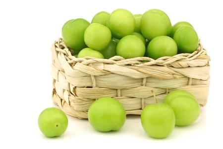jujube fruits: fresh jujube fruit  Ziziphus jujuba  in a woven basket on a white background