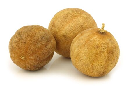 dried  white lime  fruit on a white background  photo