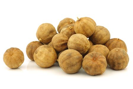 bunch of dried  white lime  fruit on a white background  photo