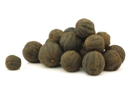 bunch of dried  black lime fruit on a white background  photo