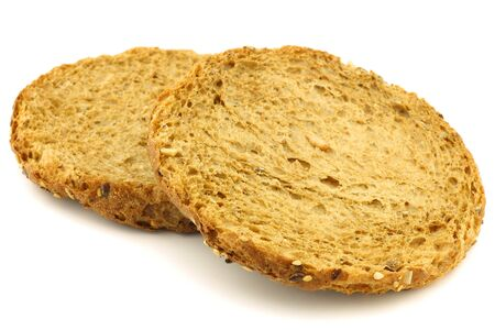 crackers: two Dutch traditional  Waldkorn  wholemeal rusks on a white background  Stock Photo
