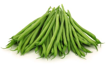 small and slender green beans  haricot vert  on a white background