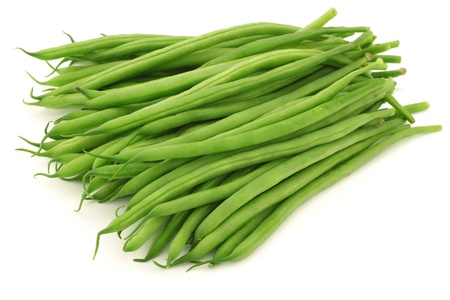 french bean: small and slender green beans  haricot vert  on a white background