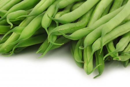 haricot vert: small and slender green beans  haricot vert  on a white background