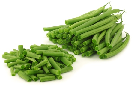 french bean: cut small and slender green beans  haricot vert  on a white background  Stock Photo