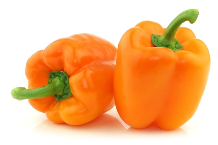 two fresh orange bell peppers on a white background  版權商用圖片