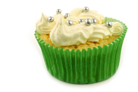 silver balls: homemade cupcake with cream and candy silver balls on a white background