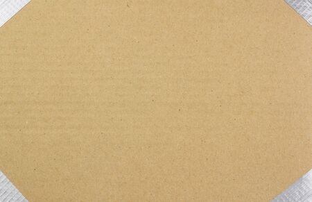 gaffer: background of brown cardboard with duct taped edges with room for text or label  copy space