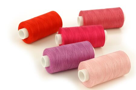 spindles: colorful spindles of yarn on a white background