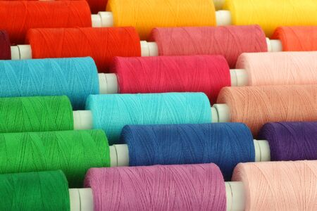 spindles: colorful spindles of yarn background  Stock Photo